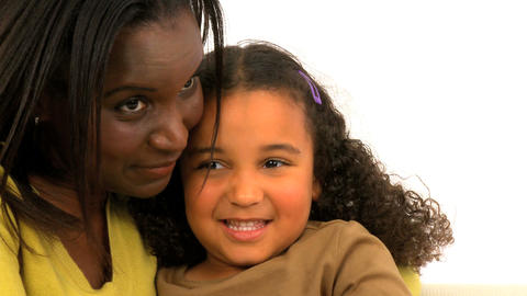 Attractive african american woman embracing her daughter Stock Video Footage