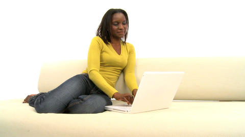 Attractive african american woman using laptop on white... Stock Video Footage