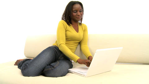 Attractive african american woman using laptop on white background, motion jib Footage