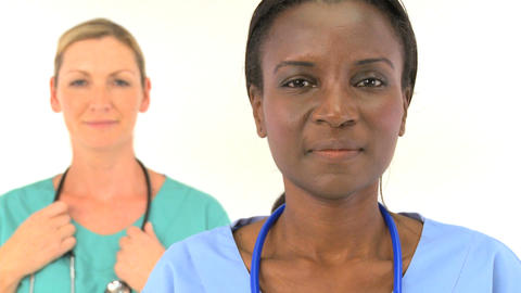 Multiethnic female medical team isolated on white Stock Video Footage