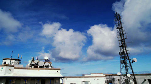 Communications tower and station time-lapse with clouds... Stock Video Footage