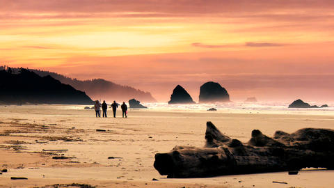 Walking on Cannon Beach at sunset Footage
