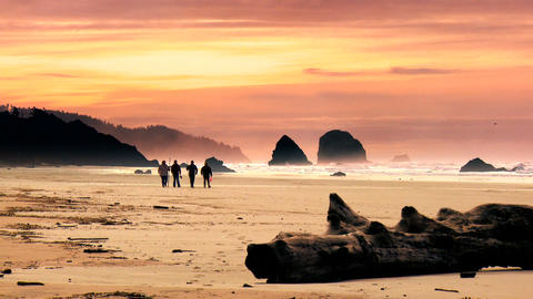 Walking on Cannon Beach at sunset Stock Video Footage