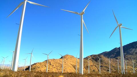 Cluster of wind turbines producing clean & renewable energy Stock Video Footage