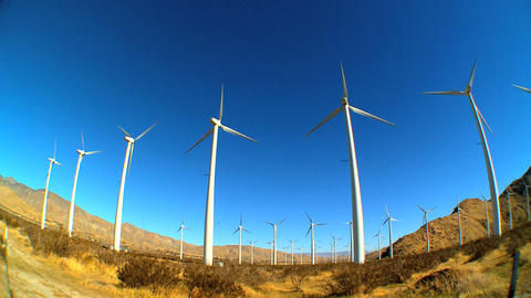 Fish-eye lens of wind turbines producing clean & renewable energy Footage