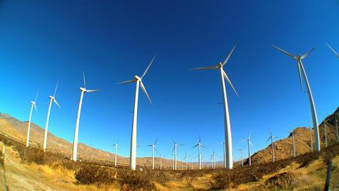 Fish-eye lens of wind turbines producing clean &... Stock Video Footage