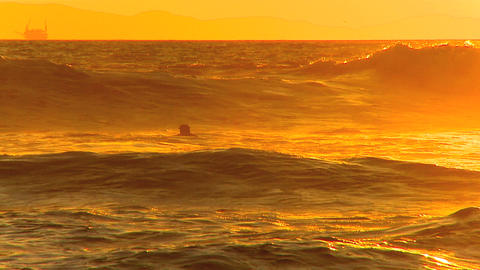 Surfer in the waves at sunset Footage