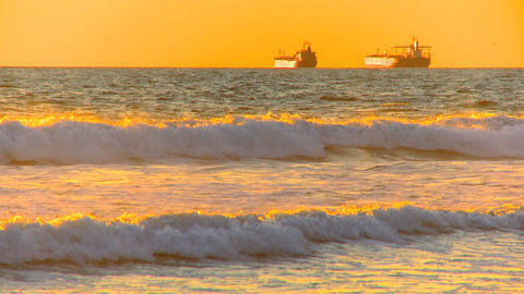 Oil tankers at sea at sunset Stock Video Footage