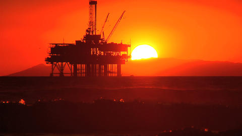 Oil platform at sea at sunset Stock Video Footage