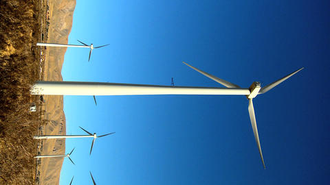 Vertical cluster of wind turbines producing clean & renewable energy Footage