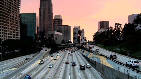 Traffic in downtown LA at dusk Stock Video Footage