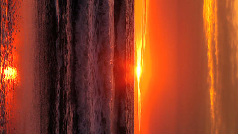 Vertical sunset on a Pacific coast beach outside Los Angeles Stock Video Footage
