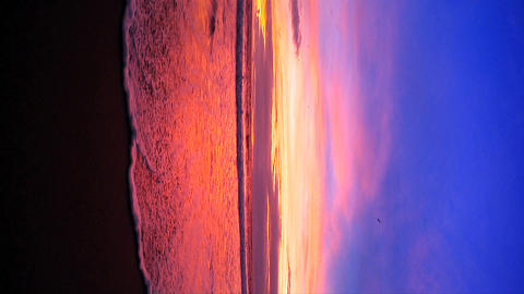 Vertical fisheye of sunset on a Pacific coast beach outside Los Angeles Footage