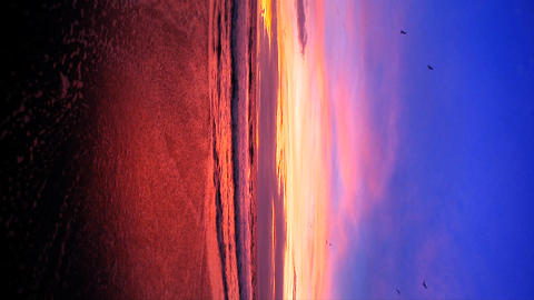 Vertical fisheye of sunset on a Pacific coast beach... Stock Video Footage