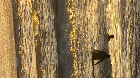 Vertical surfers ejoying the waves Stock Video Footage
