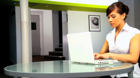 Young western oriental businesswoman working with laptop Stock Video Footage
