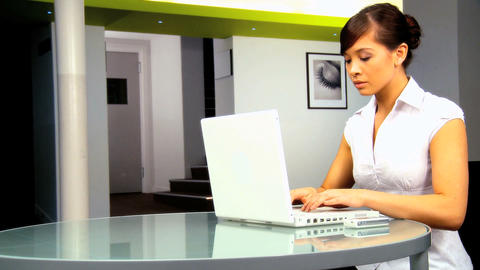 Young western oriental businesswoman working with laptop Footage