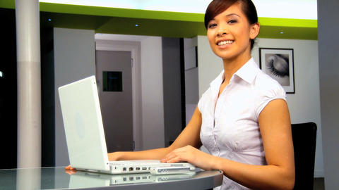 Young western oriental businesswoman working with laptop computer Footage
