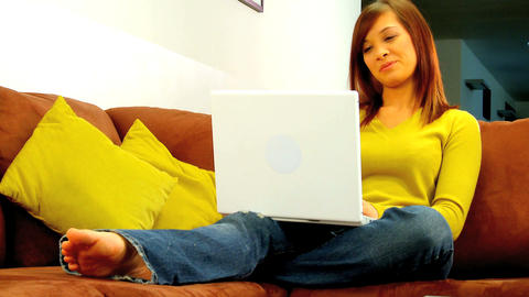 Young western oriental girl relaxing at home while using... Stock Video Footage