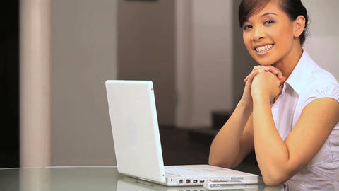 Young western oriental businesswoman at work using a... Stock Video Footage