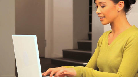 Young western oriental businesswoman at work using a laptop computer Footage