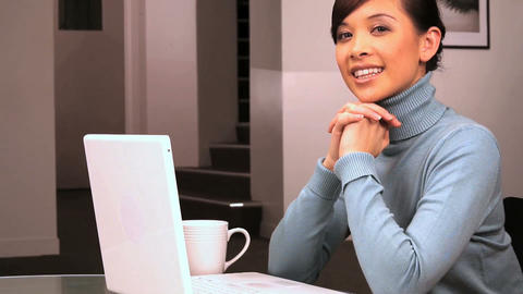 Young western oriental business woman working in her office Footage
