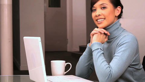 Young western oriental business woman working in her office Stock Video Footage
