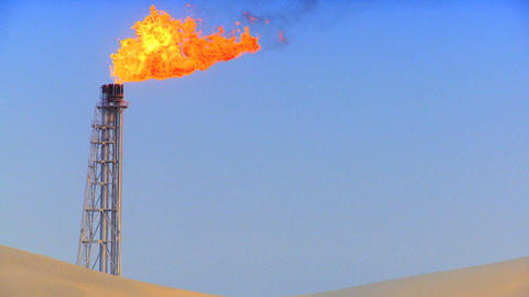 Excess gas being burned off at energy production plant Stock Video Footage