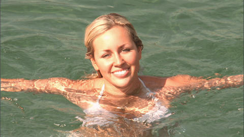 Beautiful blonde girl enjoying the mediterranean lifestyle Stock Video Footage