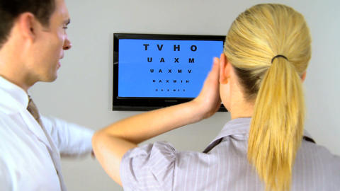 Ophthalmic optician working with patient Footage