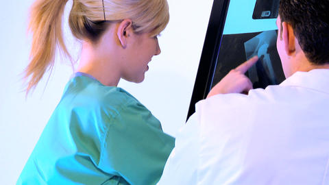 Healthcare staff working with x-ray charts Stock Video Footage