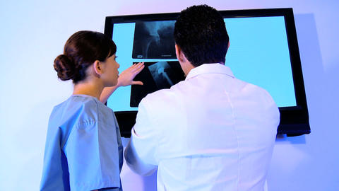 Western oriental & caucasian healthcare staff using x-ray... Stock Video Footage