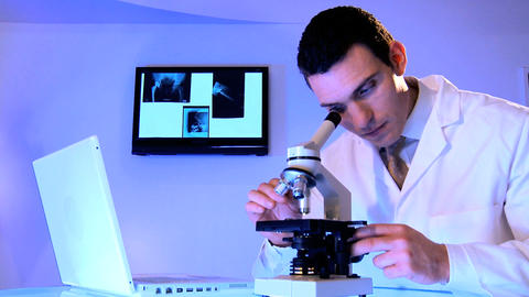 Male caucasian healthcare staff using laboratory equipment Stock Video Footage