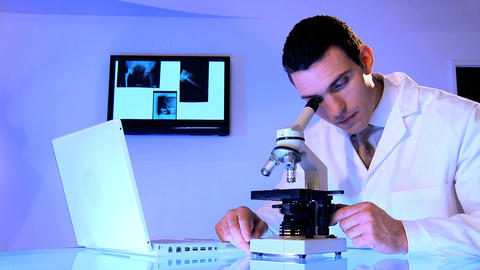 Male caucasian healthcare staff using laboratory equipment Stock Video Footage