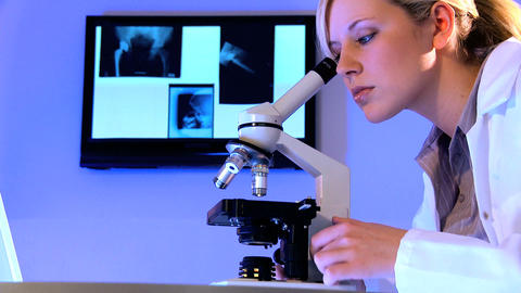 Young female healthcare staff working with laboratory equipment Footage