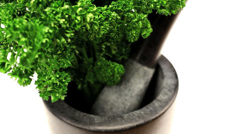 Studio close-up of fresh vegetables with pestle & mortar Footage