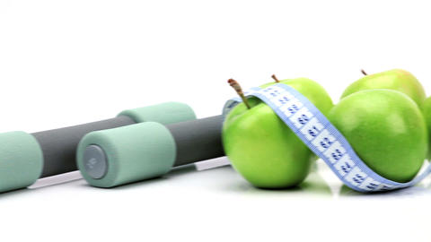 Studio close-up of fresh fruit & exercise aids for healthy living Footage