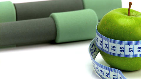 Studio close-up of fresh fruit & exercise aids for... Stock Video Footage