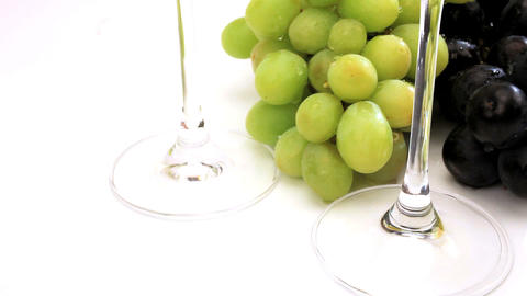 Studio close-up of fresh grapes & wine glasses Stock Video Footage