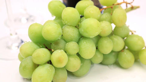 Studio close-up of fresh grapes & wine glasses Footage