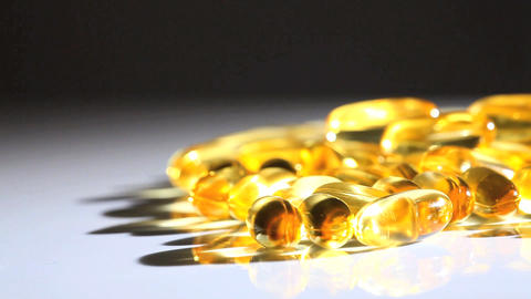 Studio close-up of vitamin capsulesfor healthy living Stock Video Footage