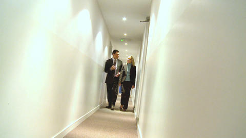 Young colleagues talking on their way to a business meeting Stock Video Footage