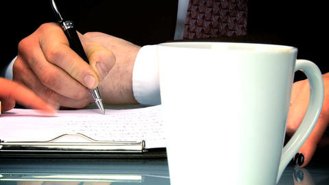 Close shot of hands & table at a business team meeting Stock Video Footage