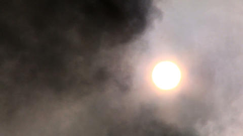 Black smoke being pumped into the atmosphere obscuring... Stock Video Footage