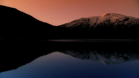 Time-lapse sunrise over a glacial fjord Stock Video Footage
