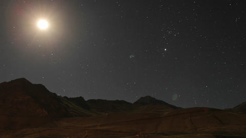 Aconcagua Time Lapse - Moon traveling across mountain sky Stock Video Footage