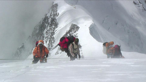 Sherpas and Climbers in heavy winds Stock Video Footage