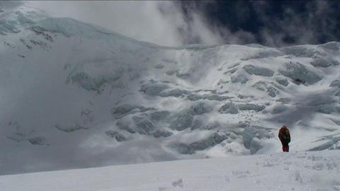 Climber walking towards big ice wall Stock Video Footage