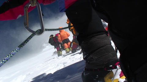 Low angle of climbers stopped in high winds Stock Video Footage