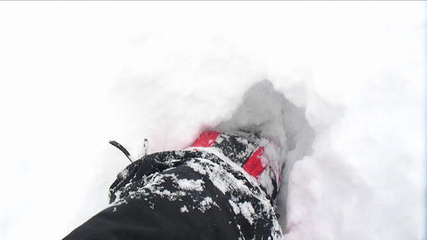POV of climber walking through deep snow Footage